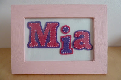 Mia name framed in felt