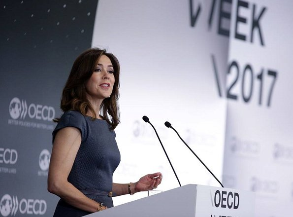 Crown Princess Mary attended the opening of OECD forum at Oecd Conference Centre in Paris. wore Prada dress Gold earrings