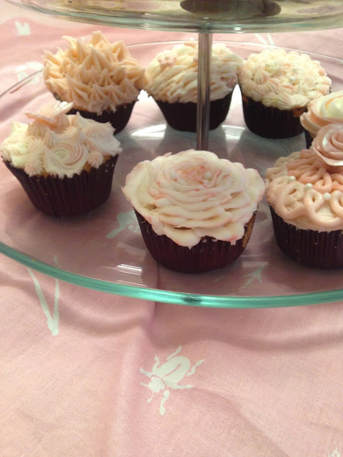 Beautiful assortment of valentine cupcakes in vanilla and buttercream frosting