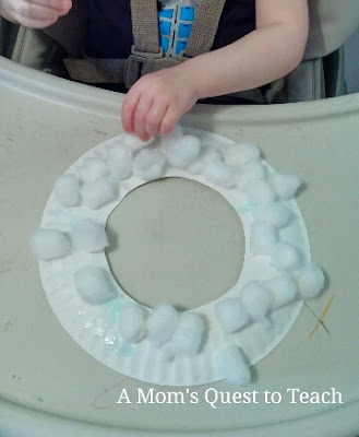 Gluing cotton balls on paper plate mask
