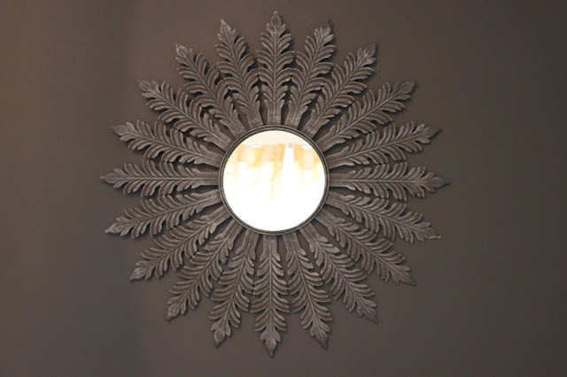 Looking to update a piece in your home and get that antique look? Check out my super simple DIY Antique Gold Starburst Mirror
