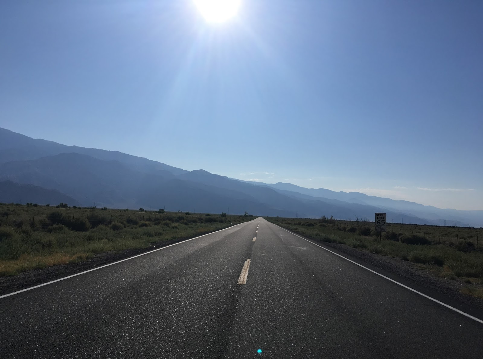 the route of ca 136 is located above the owens lake basin and is one of the few state highways in california signed at 65 mph