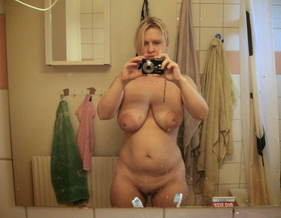 Naked Woman In Mirror