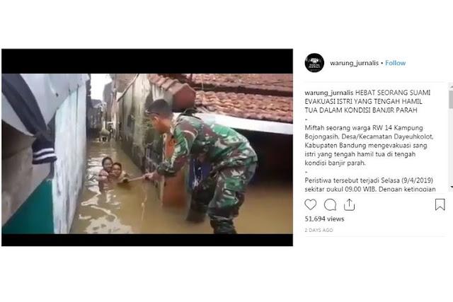 Viral, Suami Gendong Istri Hamil Terjang Banjir di Kabupaten Bandung
