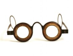 "A pair of Martin's Margin spectacles with temple arms in steel and horn, 1750-1760, United Kingdom. Benjamin Martin developed his glasses in the 1750s. They had reduced aperture lenses on account a thick horn margin which was not only an optical innovation but also created the highly characteristic appearance of the frames which became known as ""Martin's Margins""."