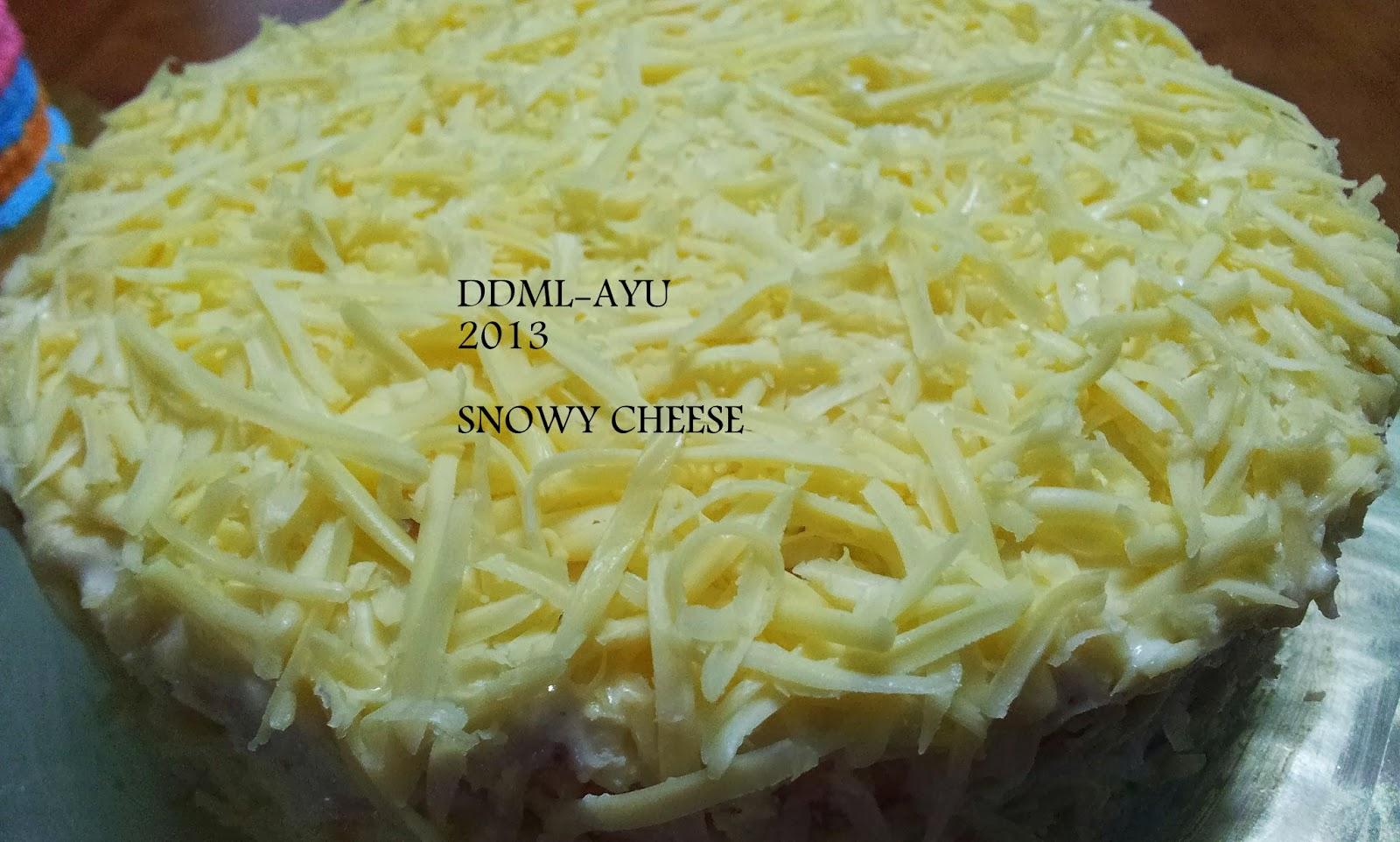 Parutkan Cheddar Cheese Di Atas Kek Tadi