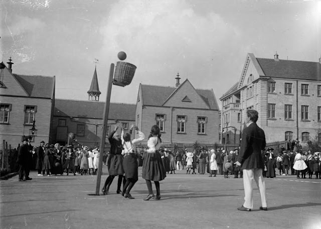 Girls basketball 1910. Woven basket attached to pole. Baskets and Ladders. marchmatron.com