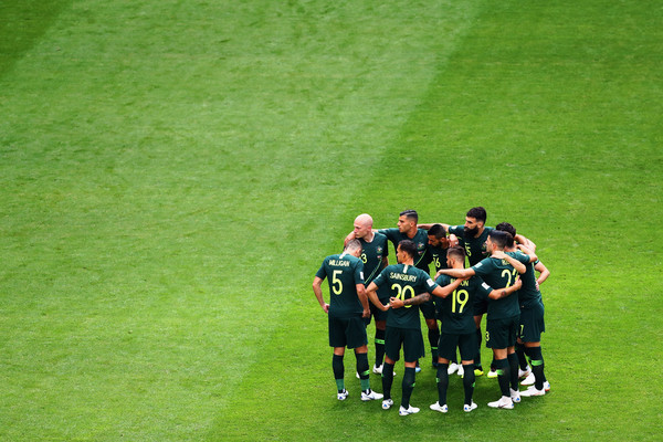 Australia players led by captain, Mile Jedinak huddle during the 2018 FIFA World Cup Russia group C match between Denmark and Australia