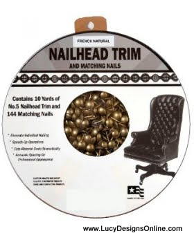 roll of upholstery nail head trim to embellish Christmas trees
