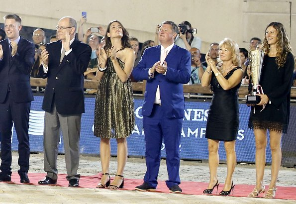 Prince Albert of Monaco and Charlotte Casiraghi attended award ceremony of Monaco Longines Global Champions Tour 2018. Charlotte wore Gucci dress