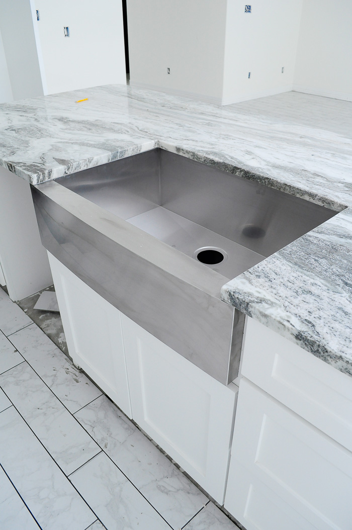 Single basin apron front sink in a home being built by a builder.