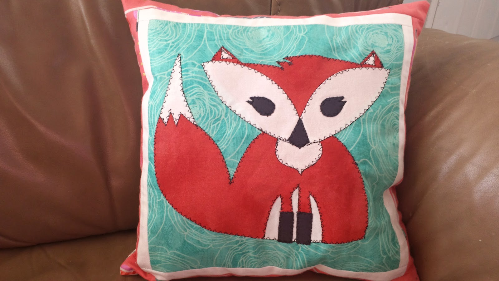 appliqued fox pillow
