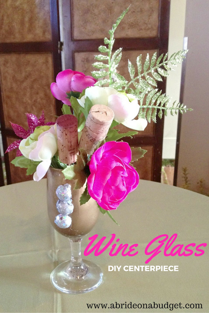 Having a vineyard wedding? Or maybe you just like wine. Check out this Wine Glass DIY Centerpiece on www.abrideonabudget.com.