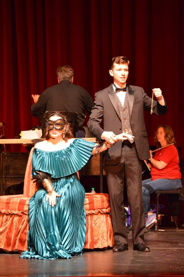 IN REVIEW: soprano TAMARA BELIY as Rosalinde (left) and baritone MICHAEL FRIEDRICH as Gabriel von Eisenstein (right) in UNCG Opera Theatre's October 2019 production of Johann Strauss II's DIE FLEDERMAUS [Photograph © by Amber-Rose Romero, Tamara Beliy, & UNCG Opera Theatre]
