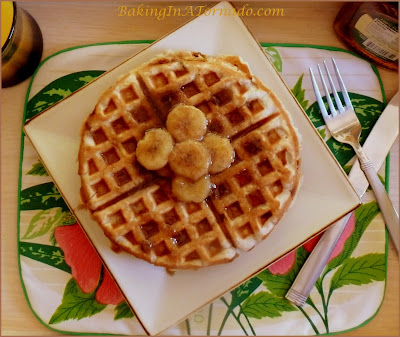 Banana Bread Waffles with Cinnamon Banana Glaze: all the flavors of a warm slice of banana bread made into a waffle with a cinnamon banana glaze over the top | Recipe developed by www.BakingInATornado.com | #recipe #breakfast