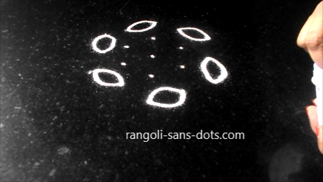 white-rangoli-black-background-272a.jpg