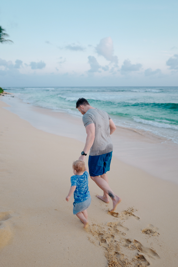 father & son running on the beach - Kauai