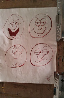 Cartoon faces in red ink drawn by Gloria Poole / Gloria in Atlanta, Ga 1995