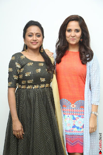 Actress Suma in Black Salwar Suit and Anusuya in orange Dress at winner movie press meet part 1 February 2017 (50).JPG