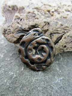 https://www.etsy.com/listing/161716625/tentacle-kraken-swirl-bronze-charm?ref=shop_home_active