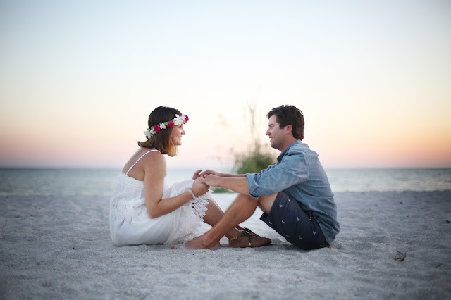 sanibel island wedding image sitting on the beach with a flower crown
