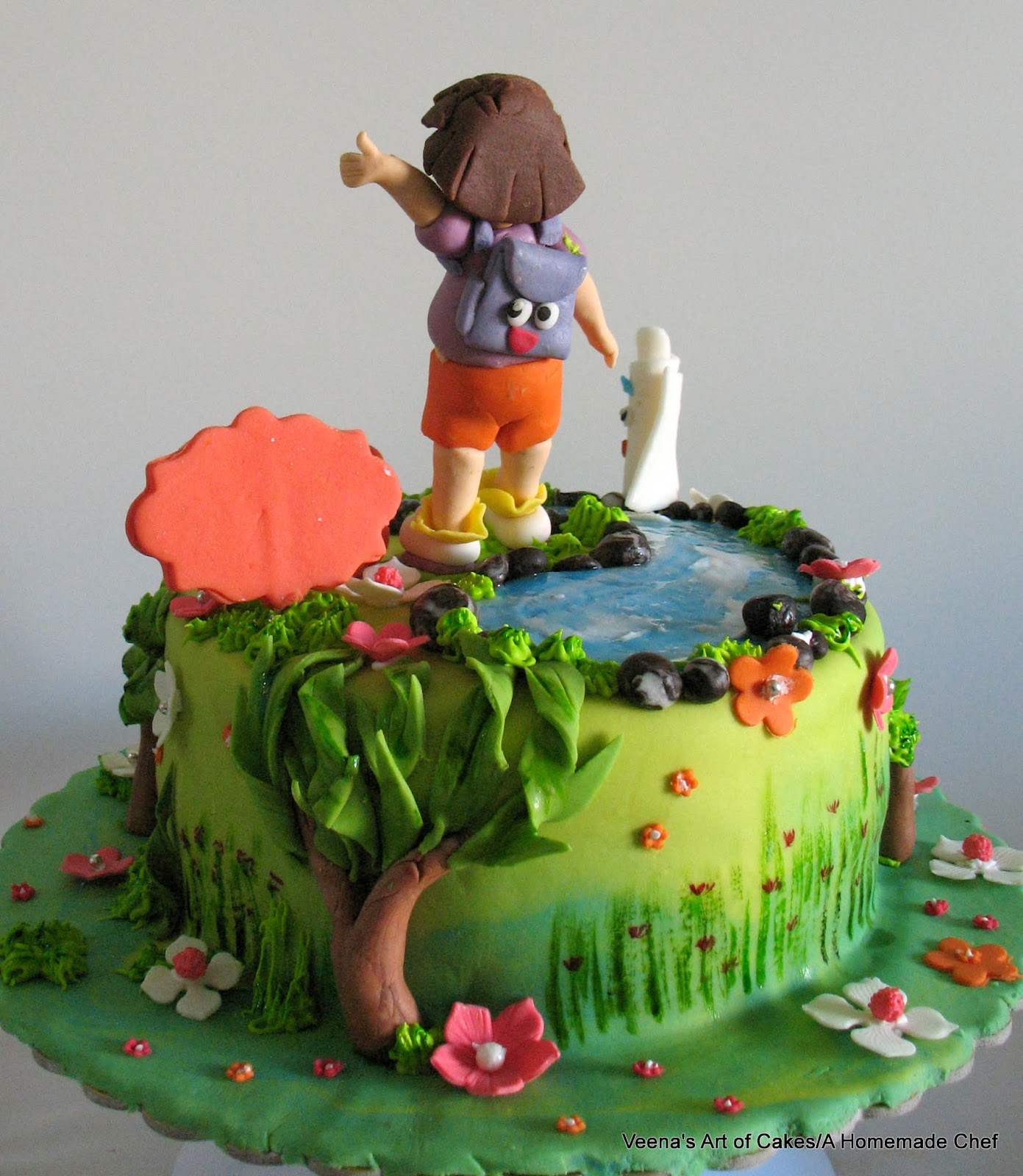 A cake decorated with Dora the explorer theme.