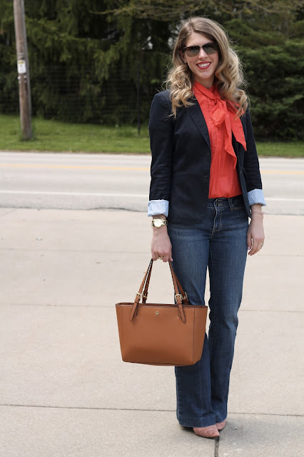 coral bow tie blouse, navy blazer, flare jeans, Tory Burch tote, blush heels, casual spring work look, flare jeans outfit