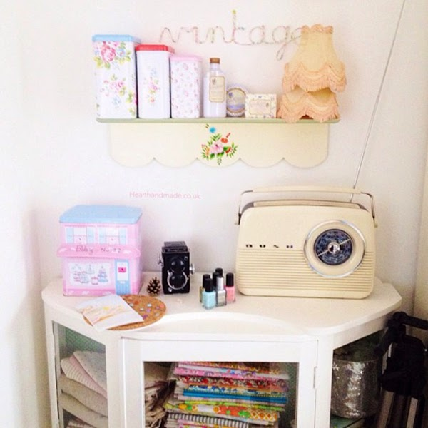 Painted vintage cabinet and retro reproduction radio. Thats a cream and mint rice dk shelf from 2011