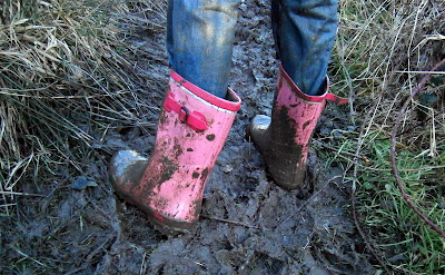 pink muddy wellies thick mud