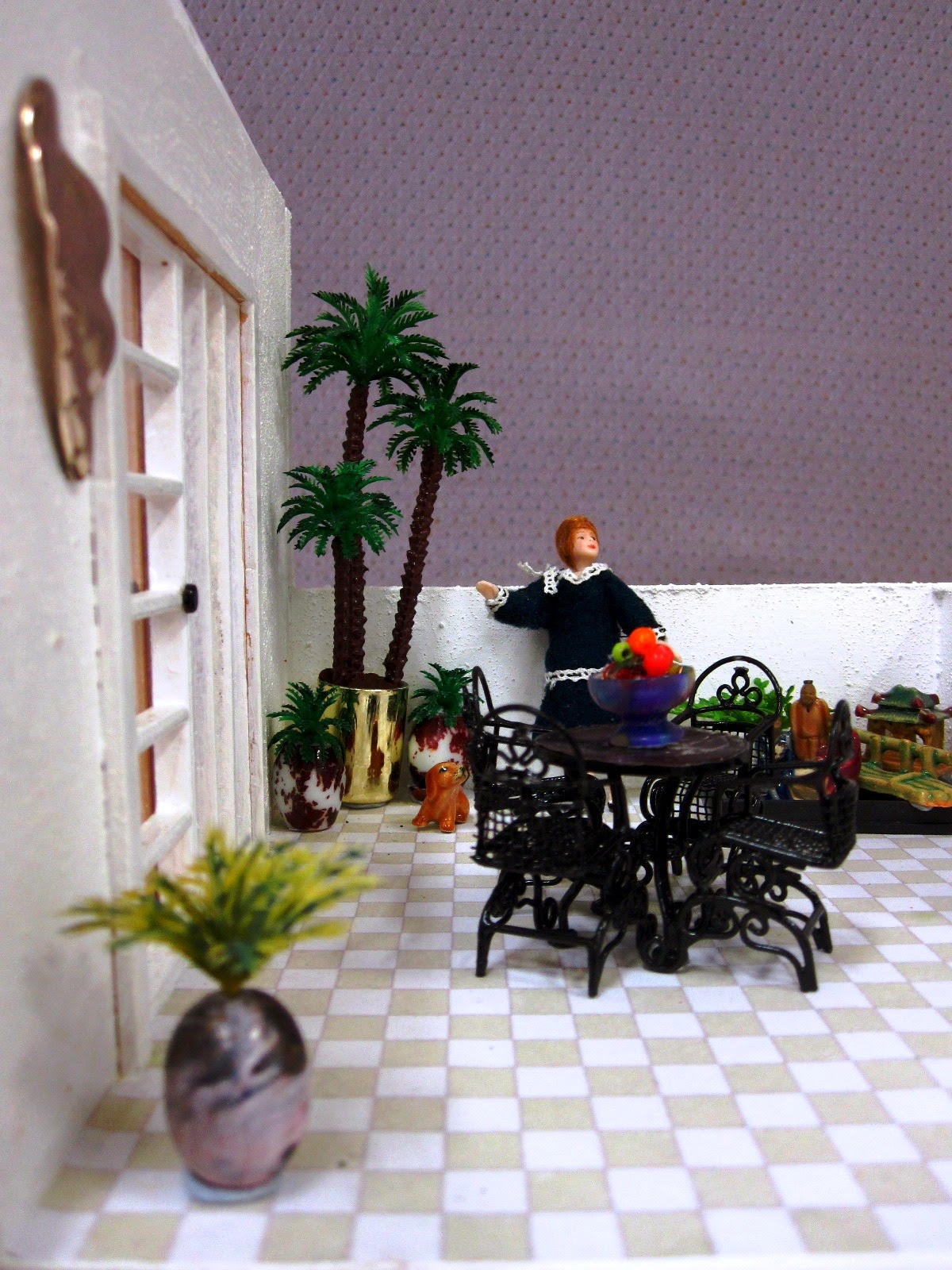 Roof patio of an Art Deco moderne-style dolls house by Anne Reid