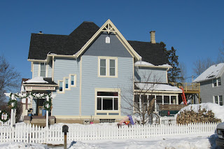 Home as repairs near completion (snow, sunny)