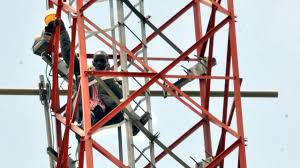 Man climbs telecom mast in protest