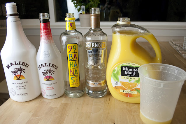 a tropical dream cocktail, vanilla vodka, malibu rum with mango, coconut rum, banana schnapps, orange juice, pineapple juice