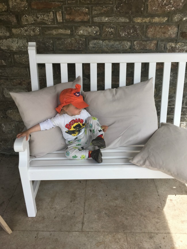 toddler-sat-on-bench-in-Pompeiian-garden-Dyffryn-Gardens