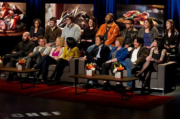 Top Chef Season 9 chefs sit in double rows of chair for reunion