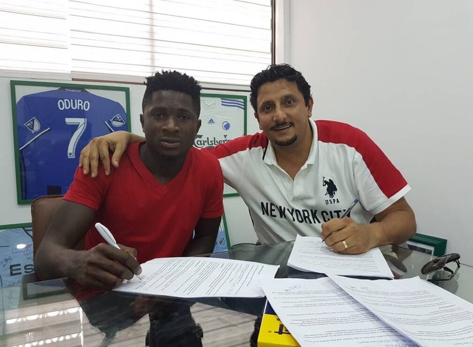 Afeez Aremu signing his contract papers for Inter Allies
