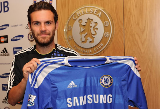 New Chelsea signing Juan Mata poses with his new jersey