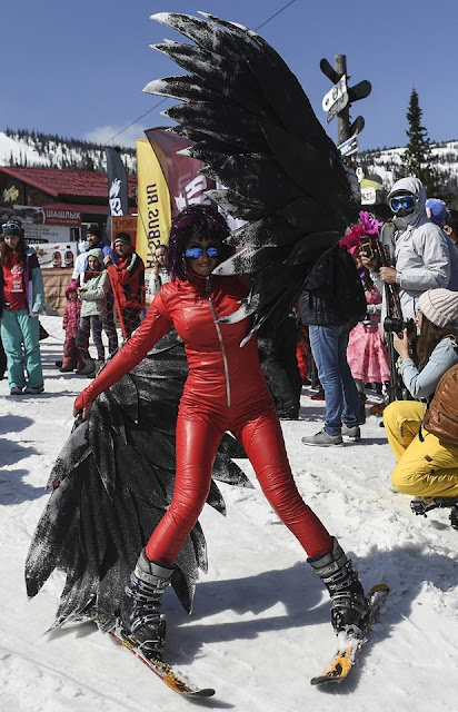 Costume festival brings bikini babes, superheroes, Putin to a Russian ski resort