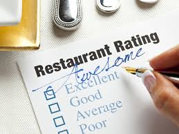 A comment card is given to a customer of a restaurant for them to leave their thoughts on the meal or service