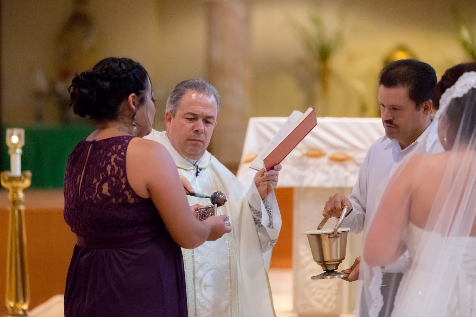 Priest Blessing a Bridesmaid