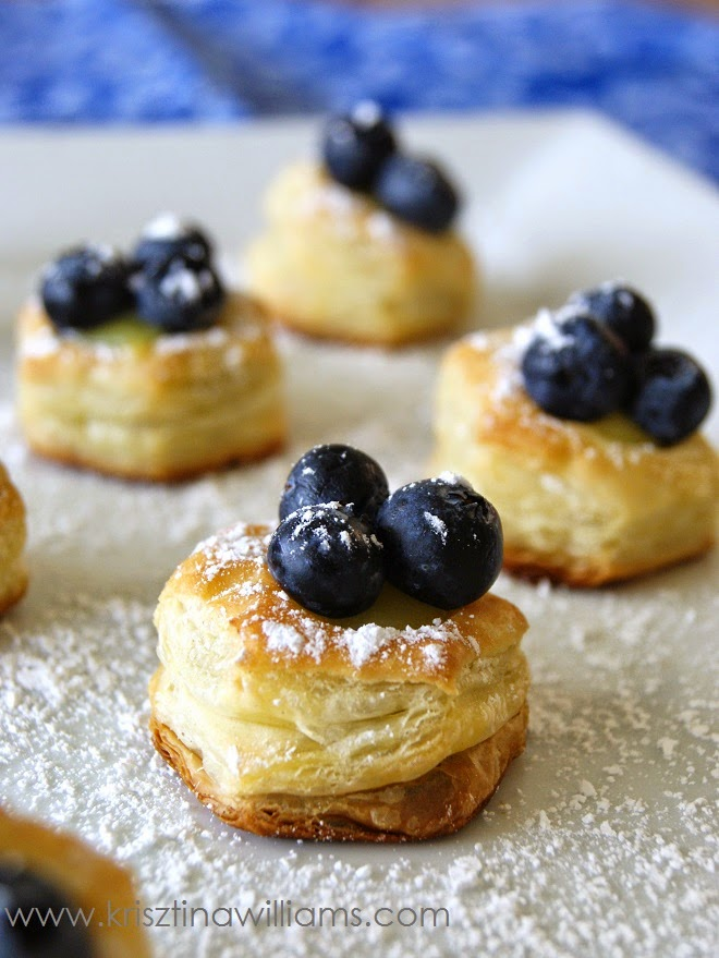 http://www.krisztinawilliams.com/2015/05/blueberry-lemon-puff-pastry-bites.html