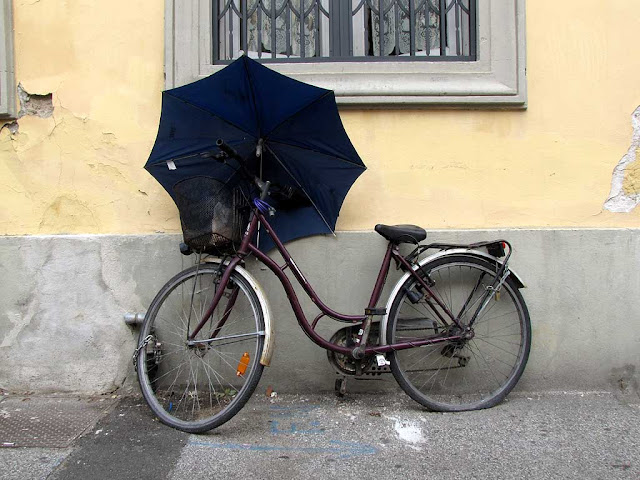 Bicycle with an umbrella and a flat tire, Livorno