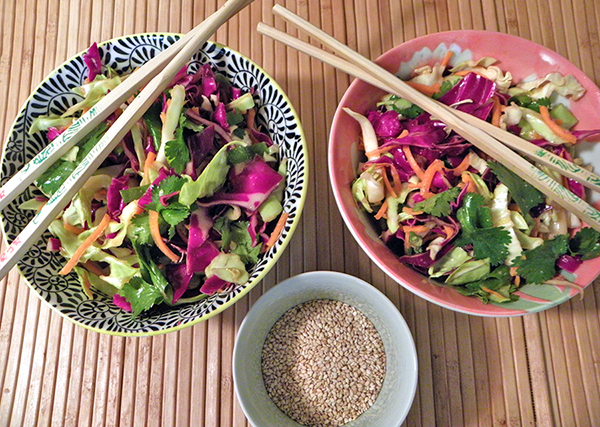 Two Bowls of Asian Salad with toasted Sesame Seeds on the Side