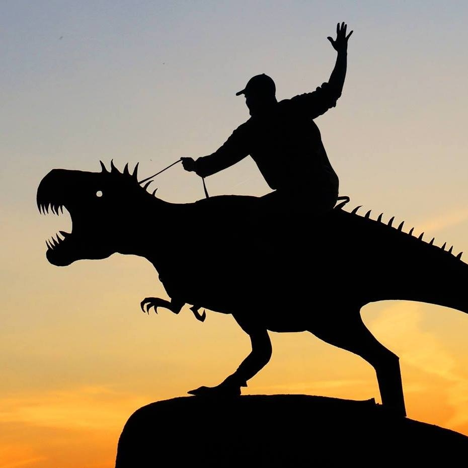 04-T-Rex-Riding-John-Marshall-Sunset-Selfie-Photographs-with-Cardboard-Cutouts-www-designstack-co