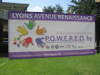 Lyons Avenue Renaissance sign with numerous partners listed