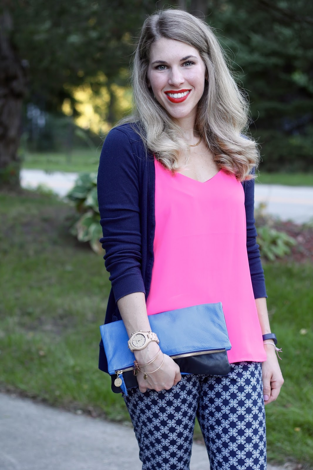Pink Barcelona cami, navy cardigan, printed blue pants, gold sandals, blue Clare V. clutch