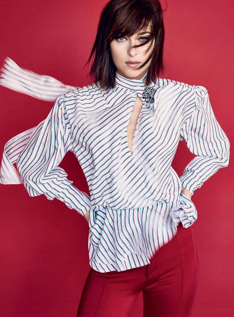 Dakota Johnson poses in Balenciaga top and pants with R.J. Graziano brooch