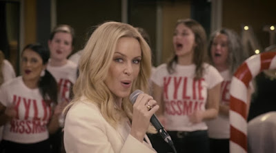 "Kylie Performs ""At Christmas"" With Warner Music Uk Choir"