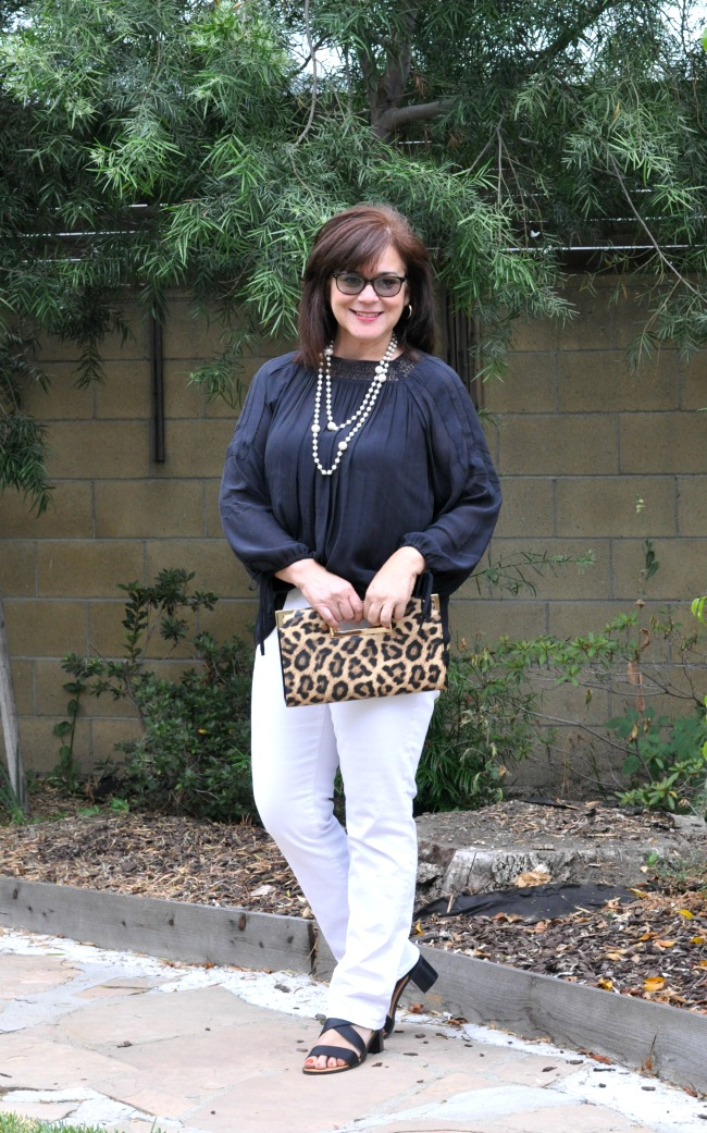 white jeans and black blouse