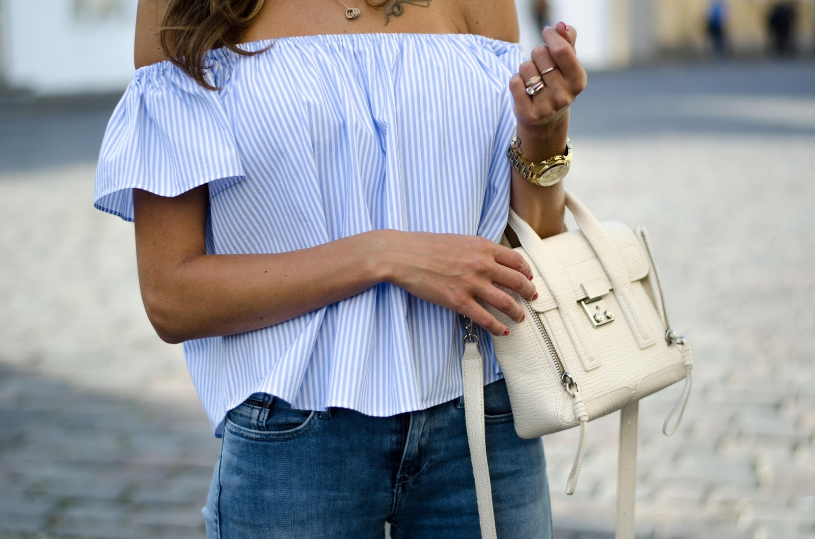 blue striped off shoulder top 3.1 phillip lim mini pashli bag